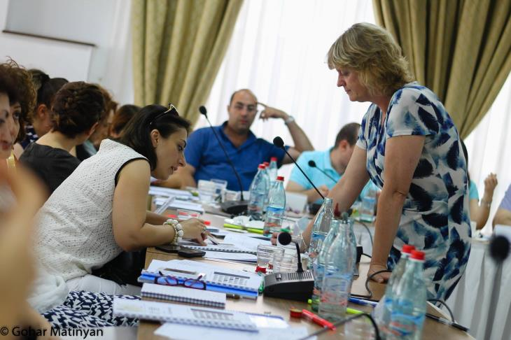 Clare working with managers in Armenia